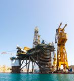 Oil platform, repair in the harbor. Oil platform repair Shipyards harbor of Malta in clear weather on a background of blue sky Royalty Free Stock Photos