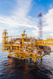 Oil platform in the sea. Oil platform yellow color in the sea Stock Photo