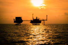 Oil platform silhouette. When sunset Royalty Free Stock Photography