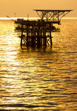 Oil platform at sunrise Stock Photos