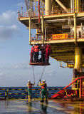 Oil platform worker. Transfer from oil rig to vessel using platform crane and personal basket during calm weather at angsi oilfield stock photos
