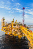 Oil platform. Yellow color in the sea Royalty Free Stock Images
