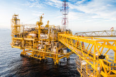 Oil platform. Yellow color in the sea Stock Photography