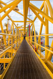 Oil platform. Yellow color in the sea Stock Photos