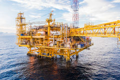 Oil platform yellow color. In the sea Stock Photo