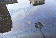 Oil Polluted Street. Oil pollution in a city street Royalty Free Stock Photography