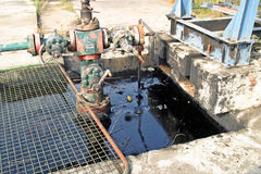 Oil pollution. Leaking oil from pipes. Ground pollution Royalty Free Stock Images
