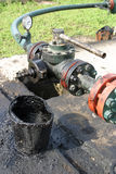 Oil pollution. Leaking oil from pipes. Ground pollution Royalty Free Stock Photo