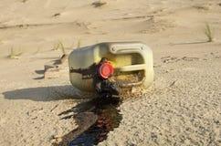 Oil pollution. Oilcan spilled on a beach Stock Photos