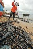 Oil polution on the beach Stock Photo