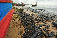 Oil polution on the beach Stock Image