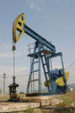 Oil pomp. A oil pomp working in a field royalty free stock photo