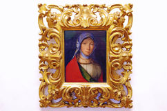 Oil portrait painting of a girl. In a golden frame. Uffizi Gallery, Florence, Italy royalty free stock photo
