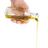 Oil pouring from a bottle. Stock Image