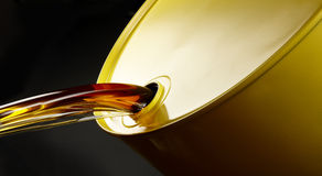 Oil pours out of barrel Royalty Free Stock Photo