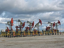 Oil power. Oil pumps in west Siberia Stock Photos