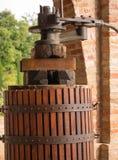Oil press. Vintage oil press and wooden barrel Stock Images