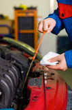 Oil pressure is measured in the car. With the dipstick is the correct oil level checked royalty free stock photography