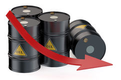 Oil price falling with oil barrels Stock Photos