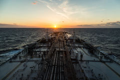 Oil product tanker is proceeding through ocean in the morning. Crude oil tanker is proceeding through ocean in the morning Stock Photo