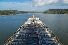 Oil tanker proceeding through Panama Canal by jungle. Oil product tanker proceeding through Panama Canal by jungle Stock Photo