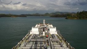 Oil product tanker proceeding through panama canal. Modern oil product tanker proceeding through panama canal at day time stock video