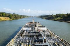 Oil product tanker is proceeding throught the Panama Canal. Oil product tanker is proceeding throught the Panama Canal at day time Royalty Free Stock Image