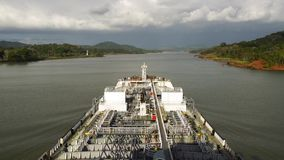 Oil product tanker is underway in panama canal turning to the right. Modern oil product tanker deck is underway in panama canal turning to the right stock footage