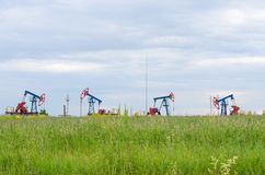 Oil production on the background of sky stock photos