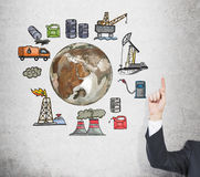Oil production, environmental pollution. An index finger pointing up at pictures symbolizing stages of oil production arranged in a circle. Brown Earth in the royalty free illustration