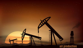 Oil production from the towers at sunset Royalty Free Stock Photography