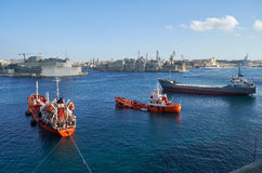 The oil products tankers and  cargo ship moored in the Grand har Royalty Free Stock Photos