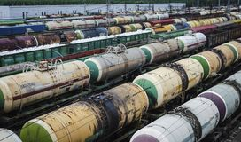 Oil products transport. Transportation of oil and gas products by railway. A large number of freight cars are waiting for shipment to the destination. The royalty free stock images