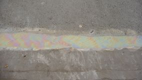 Oil puddle on cement Stock Photography