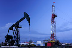 Oil pump. Oil derrick pumps oil or natural gas from underground Stock Image