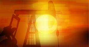 Oil Pump. Silhoutte in black against setting sun Royalty Free Stock Photography
