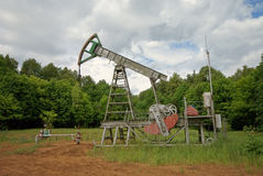 The oil pump. On a forest clearing Stock Photography