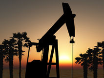 Oil pump. In the desert with palm trees Stock Photography