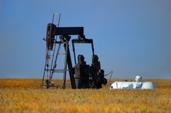 Oil Pump. In a field of wheat Stock Image