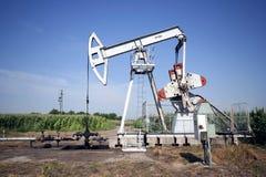 Oil pump. Against blue sky Stock Photography