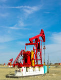 Oil pump. A red oil pump at work with blue sky in background,china Stock Photography