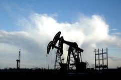 Oil pump. An industrial oil pump under a hot sky Royalty Free Stock Photos