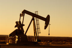 Oil Pump. Working oil pump in rural Texas at sunset Royalty Free Stock Photography