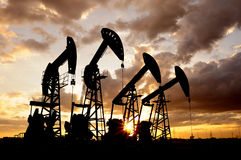 Oil pump. Oil derrick pumps oil or natural gas from underground Stock Photo