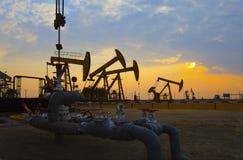Oil pump against setting sun Stock Photo