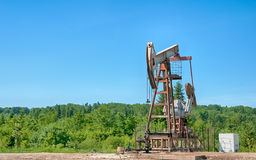 Oil pump. An oil pump is on a background mountains stock photography