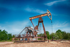 Oil pump. An oil pump is on a background mountains stock images