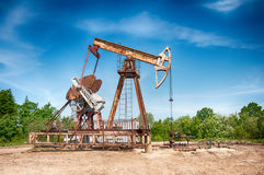 Oil pump. An oil pump is on a background mountains stock photos