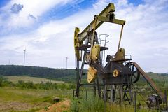Oil pump. Is on a background mountains stock images