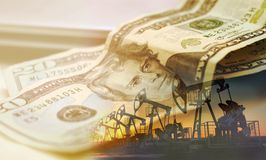 Oil pump on background of US dollar, 20 US dollars. stock photography